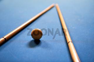 Billiard ball in a blue pool table