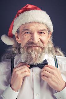 New year, Santa Claus adjusting bow tie.