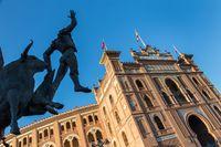 Bullfighter sculpture in front of Bullfighting arena Plaza de Toros de Las Ventas in Madrid, Spain.