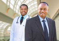 African American Businessman and Doctor Inside Medical Building.