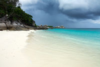 White sand beach and storm sky