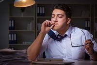 Man staying late at night and smoking marijuana