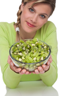 Healthy lifestyle series - Woman holding bowl of kiwi