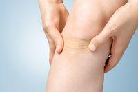 Plaster on female leg