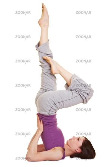 Foto Junge Frau macht Yoga-Übungen Bild #2525567