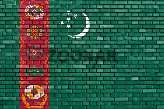 flag of Turkmenistan painted on brick wall