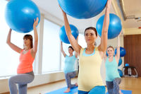 pregnant women training with exercise balls in gym