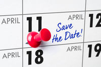 Wall calendar with a red pin - April 11