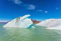 The picturesque white-blue iceberg