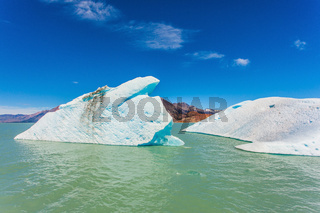 The picturesque white-blue iceberg