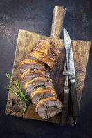 Rolled Lamb Roast on Cutting Board