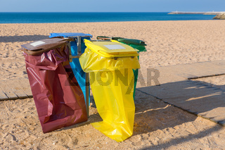 Garbage bags on portuguese beach at coast