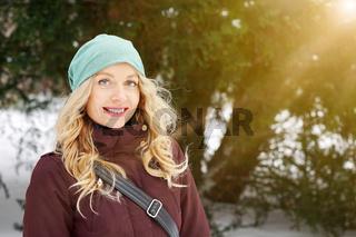 blond woman enjoying sunny day winter