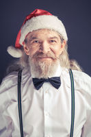 Office Santa Claus wearing white shirt and bow tie.