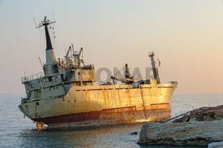 Ship aground near rocky coast