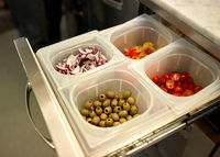 containers with food at restaurant kitchen