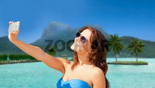 woman taking selfie by smartphone on bora bora