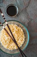 Soup Ramen noodles in glass bowl on tte gray table