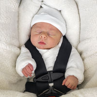 Newborn baby boy sleeping in comfortable car seat