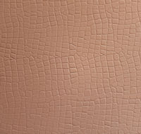 Texture of a beige leatherette close-up
