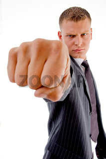 businessman showing punch