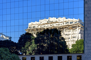 Modern glass building with refection