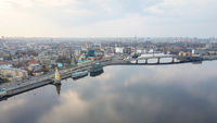 Panorama of the Dnieper embankment, Havanskyi bridge and the church of St. Nicholas on the water in Kyiv, Ukraine.