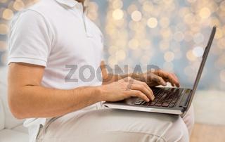 close up of man typing on laptop keyboard