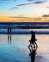 Romantic couple walk  beach Bali