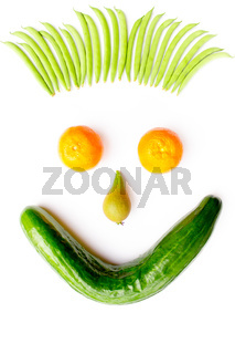 Face made of fruits and vegetables on white