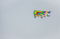 Colourful kite flying high in the sky