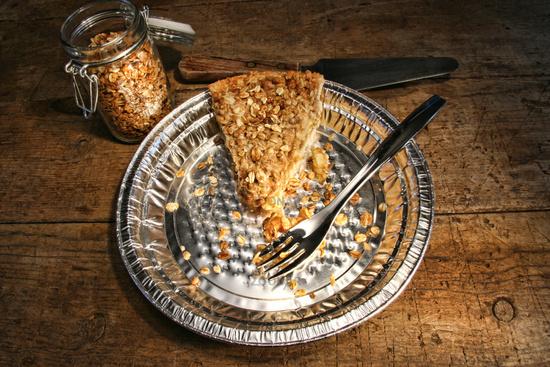 Last piece of apple crumble pie in aluminum  plate