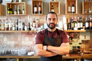 happy man, barman or waiter at bar