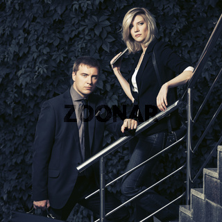 Young fashion business couple on the steps