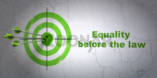 Political concept: target and Equality Before The Law on wall background