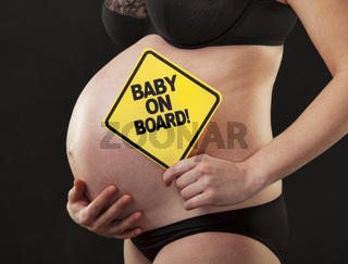 pregnant close abdomen sign