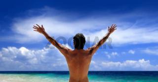 Man standing looking at ocean