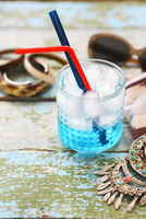 Cocktail Blue lagoon on the table background