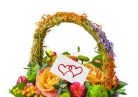 Flowers bouquet in basket and greeting card