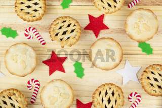 Selection of mince pies and christmas decorations