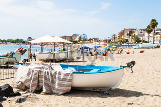 boats on urban beach in Giardini Naxos town