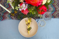 Table setting in vintage style is decorated with flowers