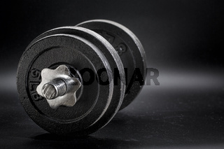 fitness concept - iron dumbbell abstract