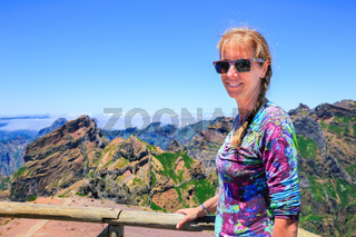 Woman as tourist with mountains in Madeira Portugal
