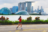 Woman jogging in Singapore bay