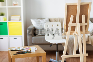 easel and artistic tools at home or art studio