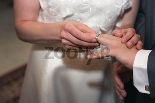 The bride and groom put on wedding rings - wedding ceremony