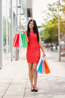 Beautiful young woman outdoors with plenty of shopping bags