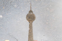 tv tower Berlin water reflection in puddle