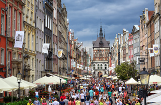 Crowded pedestrian street in Gdansk, Poland, on a summer evening